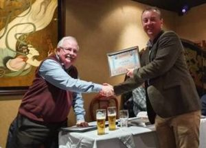 The new Club Chairman receives his certificate.